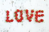 Word love made of raspberry — Stock Photo