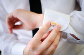Hands of wedding groom getting ready in suit — Stock Photo