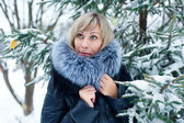 Portrait of a girl on the street in winter with snow — ストック写真