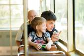 Father and son in a public transport — Stock Photo