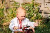 Little boy in the Ukrainian embroidered shirt in the village — Stock Photo