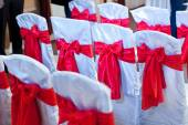 Decorated chairs at for special guests at a wedding ceremony — Stock Photo