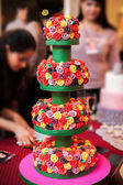 Wedding cake with colorful flowers — Stock Photo