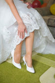 Shoes on the feet of the bride — Stok fotoğraf
