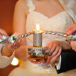 Bride and groom lighting candle — Stock Photo #62053939