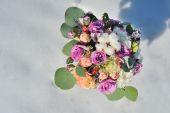 Wedding bouquet on snow — Stock Photo