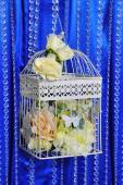 Wedding decor with flowers in cage — ストック写真