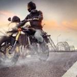 Biker riding motorcycle — Stock Photo #52375105