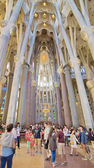 People touring the maginificent interior of the Sagrada Familia, — Stock Photo