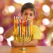 Israeli boy lighting a Hannukah Menorah — Stock Photo #61658949