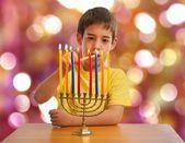 Israeli boy lighting a Hannukah Menorah — Stock Photo
