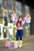 Teenage girl on a shopping spree — Stock Photo