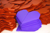 Lots of orange and blue purple paper hearts for Valentine's Day — Stock Photo