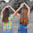 Two best friend girls making a forever sign — Stock Photo #65321295