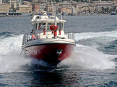 Motor boat of firefighters in action in Genoa — Stock Photo