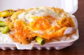 Lunch box, fried rice with pork and fried eggs,in the foam box. — Stock Photo