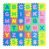 Colorful plastic toy letters spelling. Promote the development of children, autism. — Stock Photo