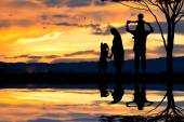 Silhouette of a happy family of five people, mother, father, baby, child and infant(women prenancy) — Stock Photo