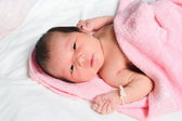 Newborn baby girl with  peeling skin (soft image) — Stock Photo
