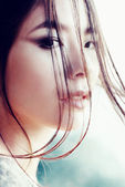 Portrait of a beautiful young girl of Asian appearance, close-up, outdoors — Stock Photo