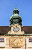 The sundial and mechanical watches on Amalienburg (Amalia Palace), Vienna, Austria — Stock Photo