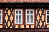 The front side of the  fachwerk house with wooden beams and windows, Wernigerode, Germany — Stock Photo