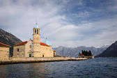View of the Our Lady of the Rocks  island   in the Bay of Kotor from a boat, Montenegro — Stock Photo