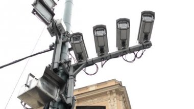 Four security cameras on the street - building in background - cloudy — Stock Video