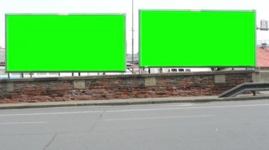 Two billboards in the city near road - green screen — Stock Video