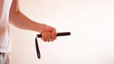 Man draw telescopic baton — Stock Video