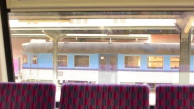 Train unit - seat in the train - a view from inside the wagon - terminal — Stock Video