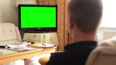 Man watches TV(television) - green screen - living room — Stock Video