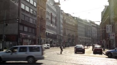 Urban street with people, cars, trams - modern buildings - road and pavement - sunny — Stock Video