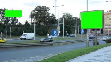 Two billboards in the city near road - green screen - building, passing cars and people in background — Stock Video