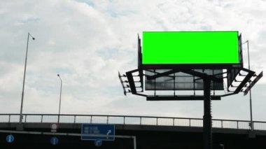 Billboard in the city near road - green screen - buildings in background — Stock Video