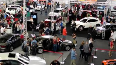Car exhibition - parked cars and people walking and watching cars - interior — Stock Video