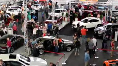 Car exhibition - parked cars and people walking and watching cars - timelapse — Stock Video