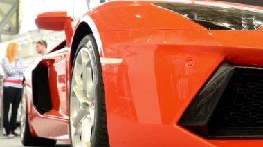 Luxury fast car (exterior) - people on exhibition - Lamborghini - Aventador — Stock Video