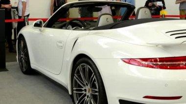 Porsche 911 turbo cabrio car (exterior) - side - people on exhibition — Stockvideo