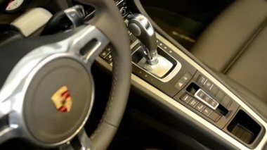 Dashboard, wheel,shift(gear) lever and detail of logo - Porsche 911 Turbo — Stockvideo