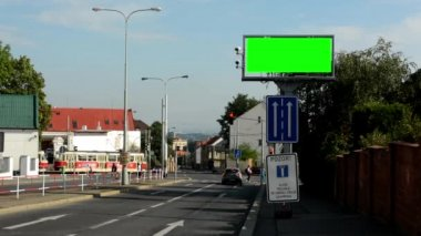 Information billboard in the city near road - green screen - security cameras — Stockvideo