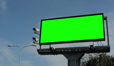 Information billboard in the city near road - green screen - security cameras — Vídeo de Stock