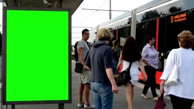 Billboard in the city and buildings - green screen - commuter people - tram — Wideo stockowe