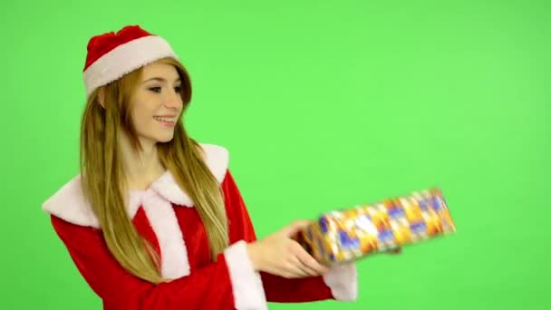 Christmas - Holidays - young attractive woman - green screen - Woman offers a gift