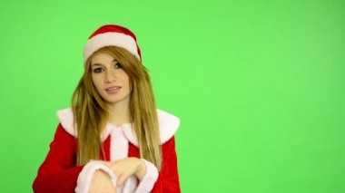 Christmas - Holidays - young attractive woman - green screen - woman shows at time (late) — Wideo stockowe