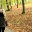 Young model couple in love - autumn park(nature) - couple (man and woman) walking in park - couple holding hands - couple talking - happy couple — Stock Video #56832987