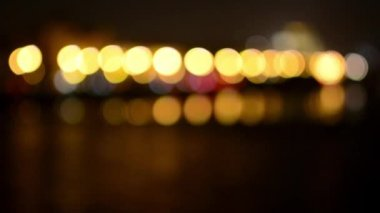Night city (night urban street with cars) with river - lamps and headlights - blurred — Stock Video