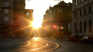 City - urban street with cars - sunrise - buildings — Stockvideo
