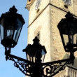 Vintage lamp (silhouette) - Astronomical Clock: Tower with blue sky - Prague, Czech Republic — Stock Video #57749343