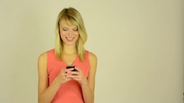 Young attractive woman works on a mobile phone (smartphone) - write a message — Stock Video